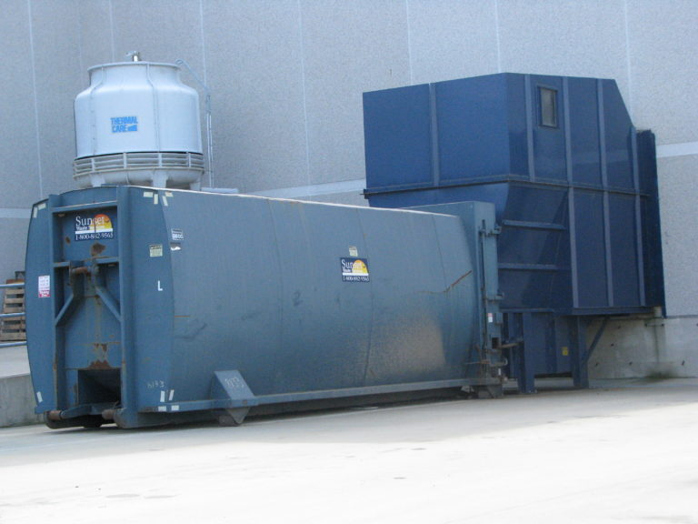 how does a trash compactor work